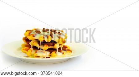 Baked Waffles With White Plate And White Plate. Covered With White Sweet Cream And Sprinkled With Ch