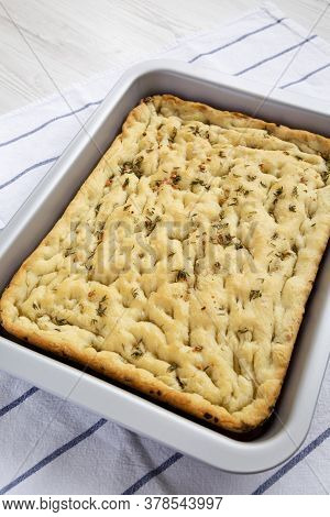 Home-baked Rosemary Garlic Focaccia Bread On Baking Tray, Side View.