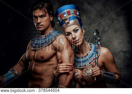 Woman In Traditional Egyptian Costume Holds Male Strong Arm And The Sign Of Power And Royalty.