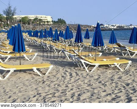 Empty Beachchairs At The Beach In Lanzarote, Canary Islands, Spain