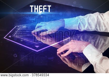 Hand touching digital table with THEFT inscription, new age security concept