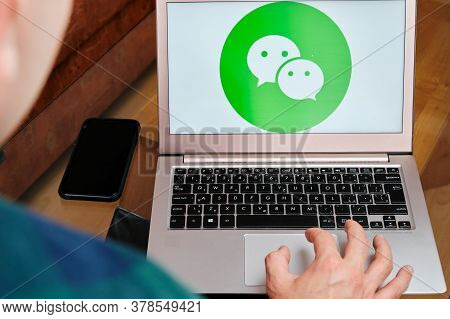 Wechat Is Used For Business Meeting On Laptop By Man. An Illustrative Editorial Image. San Francisco