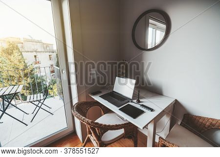 View Of A Cozy Nook In A Residential Apartment With A Work-table Near The Balcony With A Beautiful V