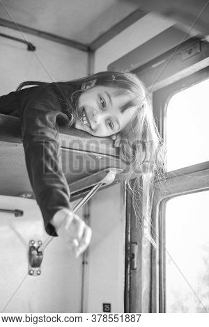The Girl Rides A Train In The Summer On A Trip. Vacation, Train Ride. A Teenage Girl Rides A Train.