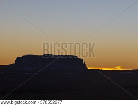 Rock Formation Of Monument Valley In Evening Backlight In Winter