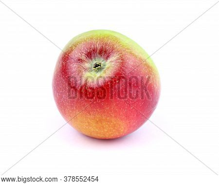 An Apple On A White Background. Healthy Food. Ripe Organic Apple.