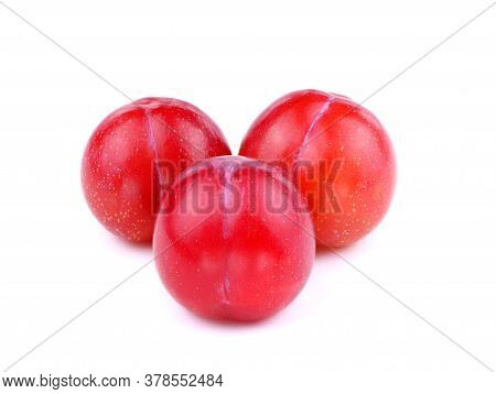 Three Red Plum Isolated On A White Background. Ripe Organic Plums. Healthy Food.