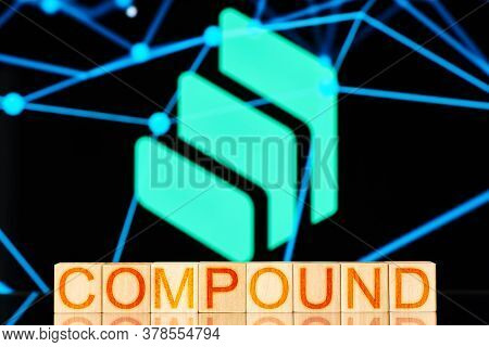 Compound. Wooden Blocks With The Inscription Compound On The Background Of The Cryptocurrency Logo.