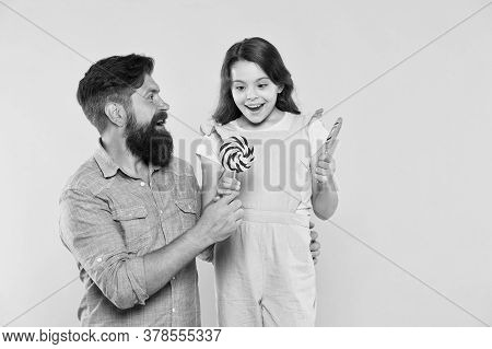 How To Please Your Child And Avoid Problems. Sweet Food. Girl Child And Dad Hold Lollipops. Sweet De