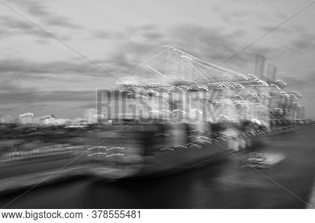 Marine Navigation Lighting. Defocused Image Of Ship. Cargo Ship In Port. Colorful Bokeh With Ship Li