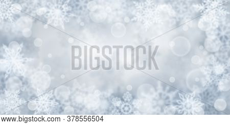 Christmas Background Of Blurry Snowflakes In Gray Colors