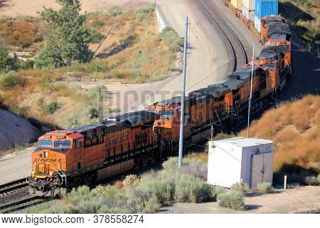 July 27, 2020 In Cajon Pass, Ca:  Freight Train With Four Locomotives Hauling Uphill Rail Cars Taken
