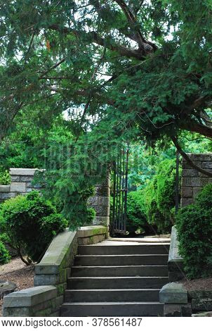 Stairway leading up to open wrought iron gate entrance