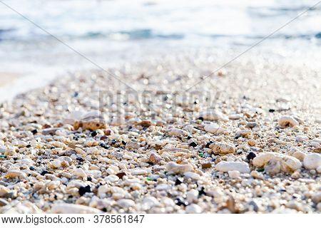 Wet Sea Pebbles Glistens In The Bright Sun.