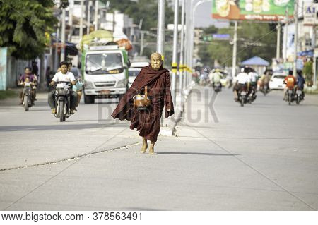 Sagaing/myanmar-october 3rd 2019: A Burmese Elderly Monk Is Walking For Food Donations From Buddhist