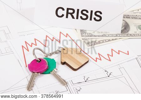 Keys With Home Shape, Currencies Dollar, Downward Graphs And Inscription Crisis On Electrical Constr