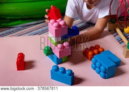 Lchild Playing With Construction Toy Blocks, Building A Tower In Kindergarten. Children At Day Care.