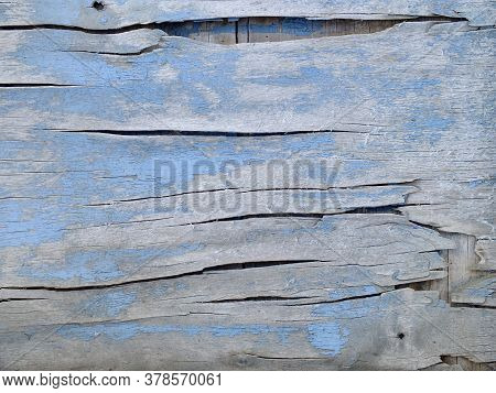 Background Image Of An Old Wooden Surface With Large Cracks And Shabby Blue Paint