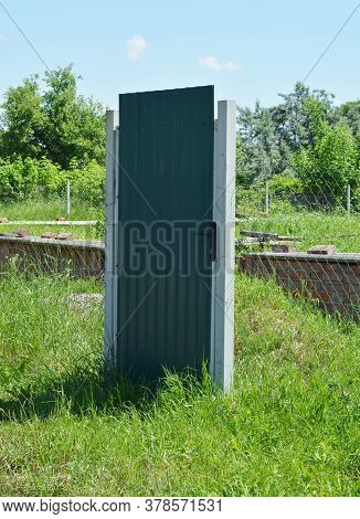 Temporary Steel Grate, Grid, Chain Link Fence With A Metal Door For A Construction Site With Built B