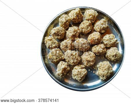 Home Made Coconut And Jaggery Sweet Balls In A Plate Isolated On White Background