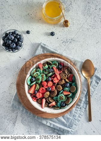 Trendy Food - Pancake Cereal. Bowl Of Multi-colored Mini Cereal Pancakes. Tiny Pancakes With Natural