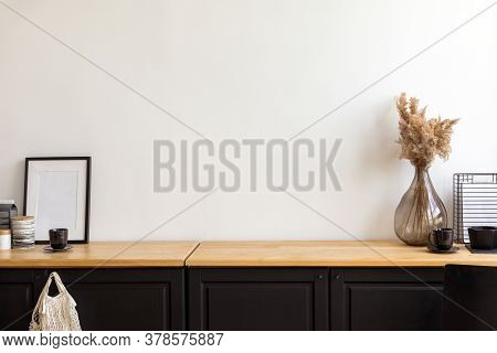 Set Of Assorted Decorations And Accessories Placed On Cupboard Against White Wall In Cozy Room At Ho