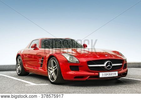 Kiev, Ukraine - May 19, 2020: Luxury Supercar Mercedes-benz Sls Amg Against The Sky. Wallpaper. For