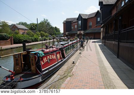 Narrowboats Moored At Banbury Lock By The Castle Quay Shopping Centre In Banbury, Oxfordshire In The