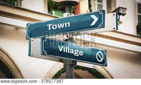 Street Sign The Direction Way To Town Versus Village