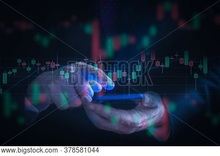 Businessman Checking Stock Market Data Using A Mobile Phone. Analysis Economy And Market Data Analyt