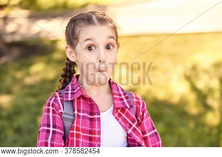 Amazed School Girl. Funny Child. Overjoyed Emotion. Young Female Kid With Backpack. Lifestyle. Outdo