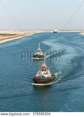 El Qantara, Egypt - November 14, 2019: Tugboats Accompanies The Ships. Ships Passing Through The Sue
