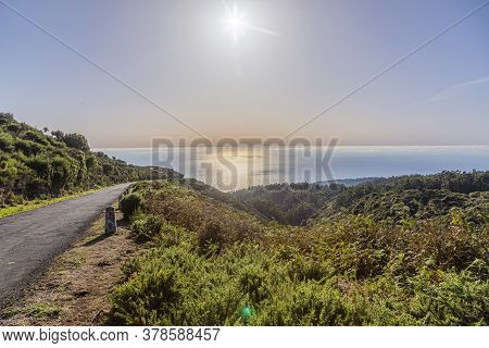 Backlight Picture Of A Small Road Taken From Summit Of Madeira Toward Atlantic Ocean In Summer