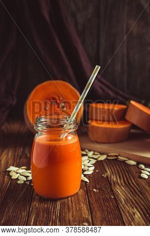 Glass Of Pumpkin Juice Placed On Table Near The Pumpkins