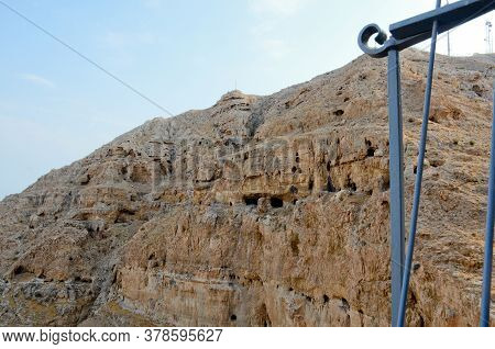 View Of The Mountain Of Temptations Of Their Greek Orthodox Monastery Near Jericho. The Concept Of P