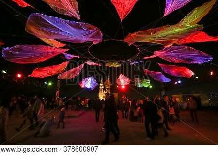 Zagreb, Croatia - 24 March, 2019 : Festival Of Lights In Zagreb. People Standing Under Lighting Inst
