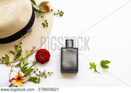 Perfume And Hat Of Lifestyle Woman Relax Summer With Purple Flowers ,zinnia ,frangipani Arrangement