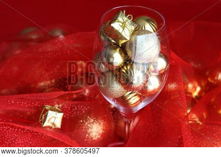 Christmas Background With Vine Glass And Gold Christmas Decorations Inside It. Vine Glass With Chris