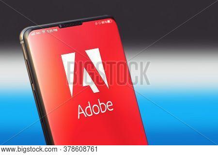 Kyiv, Ukraine-june, 2020: Adobe Mobile Application On The Smart Phone Screen. Close Up Studio Shot O