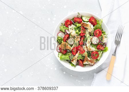 Delicious Fattoush Or Arab Salad With Pita Bread, Fresh Vegetables On Plate. Middle Eastern Bread Sa