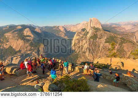 Yosemite, California, United States - July 23, 2019: Tourists At Glacier Point In Yosemite National
