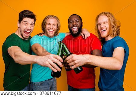 Portrait Of Excited Four Pals Men Have Weekend Toast Cheers Clink Beer Bottle Enjoy Rejoice Wear T-s
