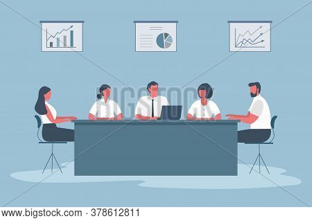 Business People During The Meeting. Office Workers Are Sitting At The Table In The Office. There Are