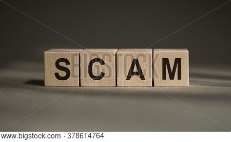 Scam Word Made With Building Wooden Blocks On Gray