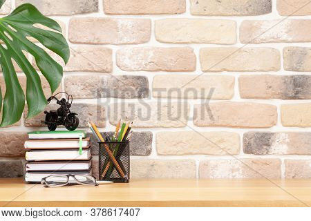 Stylish home studio workspace with office supplies and glasses. Work from home concept. With copy space for your text