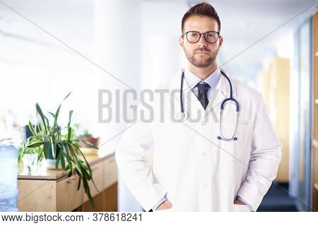 Executive Male Doctor Standing On The Hospital Folyer