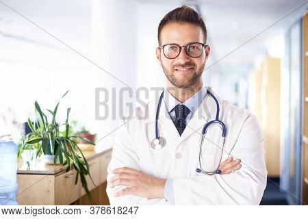 Male Doctor Standing On The Hospital Foyer