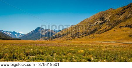 A Meadow In The Ahuriri Valley, Surrounded By Mountains On A Sunny Day, Mackenzie Country, Canterbur