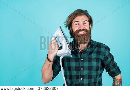 Happy Man Ironing Clothes. Man Concentrated On Ironing A Shirt. Laundry Room At Home. Clothes Ironin