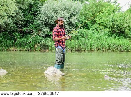 Man Bearded Fisherman. Fish Farming Pisciculture Raising Fish Commercially. River Lake Lagoon Pond.